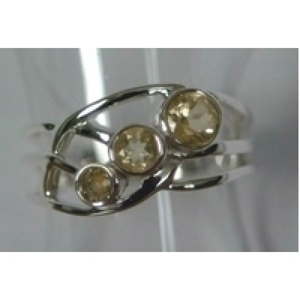 3 faceted gemstones set on an angle from smallest to largest. Set in sterling silver ring
